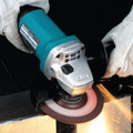 Makita 9557PB 4-1/2 in. Paddle Switch AC/DC Angle Grinder image number 1