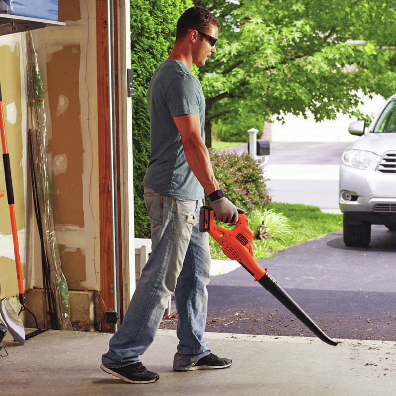 20V MAX 1.5 Ah Cordless Lithium-Ion Sweeper easily clears debris from hard surfaces like driveways, decks, and garages