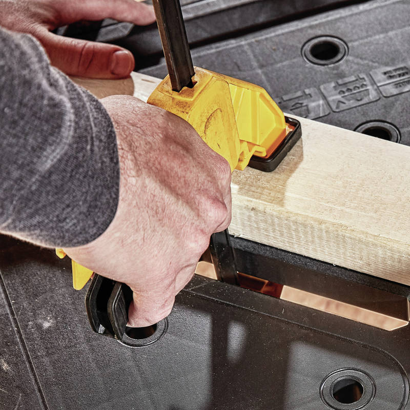 Holes throughout work surface make this compatible with DEWALT clamps